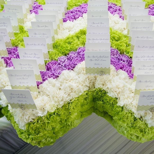 The refined menu cards sat on a bed of fresh carnations arranged in a modern color block chevron pattern.