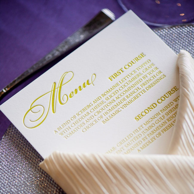 Lime green lettering added a modern pop to the understated menu cards set within a classic napkin fold.
