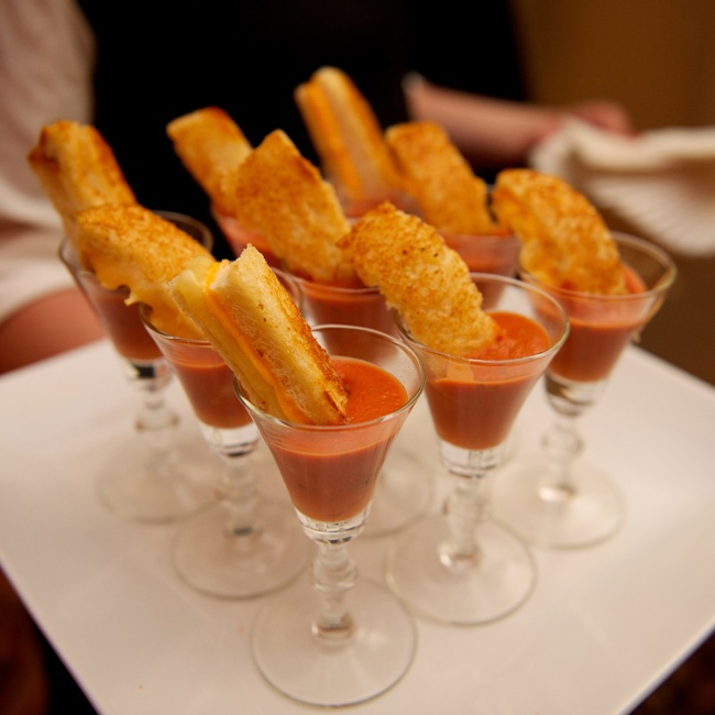 Guests enjoyed miniature grilled cheese sandwiches dunked in tomato soup as a nostalgic treat.
