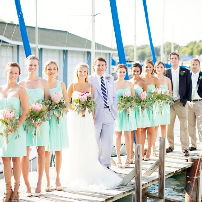 Kendra's seven bridesmaids matched mint J.Crew dresses but added personality by mixing materials—some wore chiffon while the rest wore cotton! The ladies completed their understated look with braided hairstyles and minimal accessories.