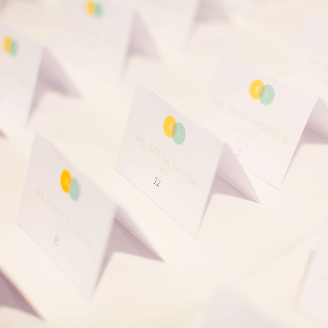 The contemporary escort cards mimicked the yellow and green design from Kendra and Lelands invitations of two intersecting circles.