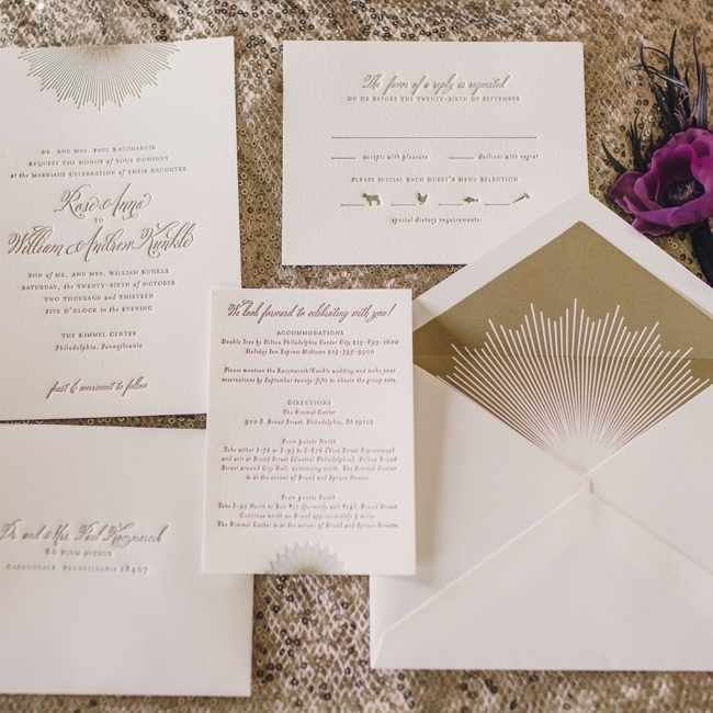 Rose and Will's white and gold invitation suite set the tone for their glam, Gatsby-inspired event with an art deco sunburst motif.