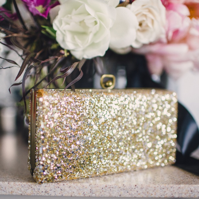 A golden, sparkly clutch was the perfect, glam accessory for the bride's ensemble.