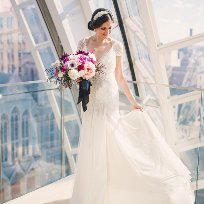 Rose chose to wear a 1920s-inspired, beaded Jenny Packham gown with chiffon cap sleeves.