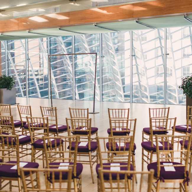 Rose and Will exchanged vows in a modern venue with the skyline of Philadelphia as their backdrop.
