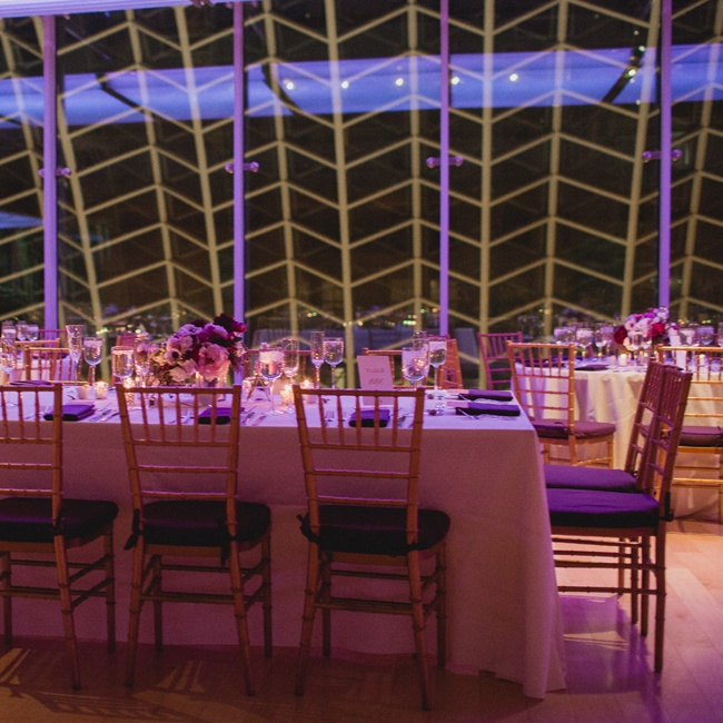 As the venue transitioned from day to night, the rows of ceremony chairs changed into long tables with white linen and as the urban backdrop faded into the night, the art deco window frames made for a fun, patterned background.
