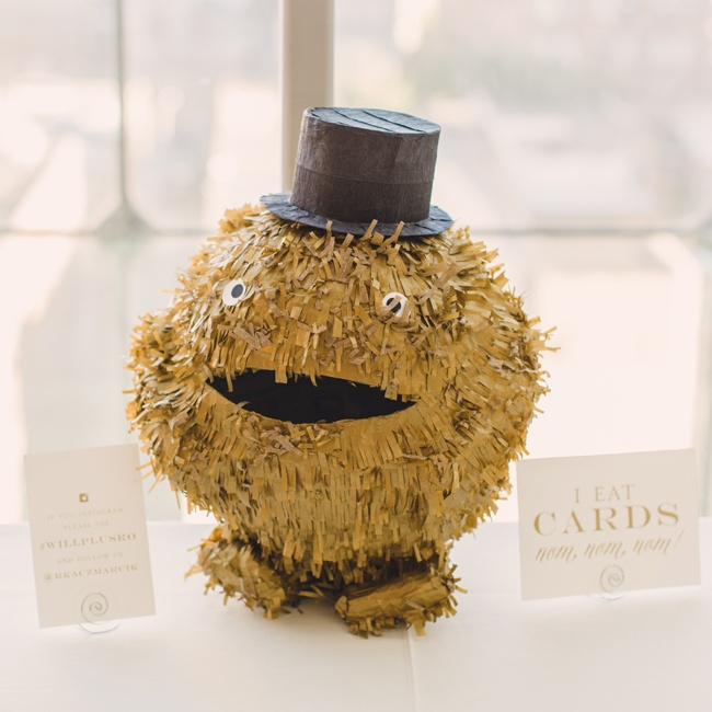 This friendly monster with a top hat ate guest's cards for the bride and groom.