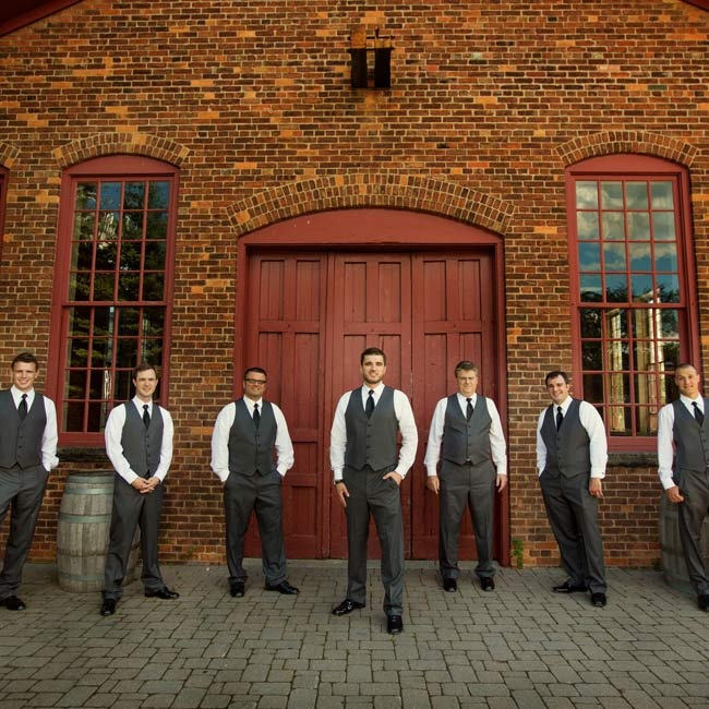 All of Peter's seven groomsmen wore gray Vera Wang tuxedos with slim black ties, forgoing boutonnieres for white pocket squares.