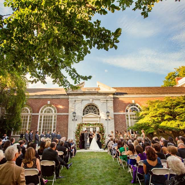Before celebrating with a vintage-industrial reception, the couple exchanged vows during an outdoor ceremony in the Pennsylvania Courtyard at the Henry Ford Museum.