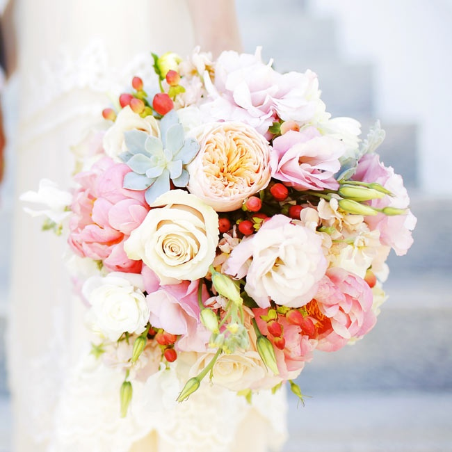 Jessica's bouquet mixed roses, lisianthuses and peonies in shades of ivory, pink and peach with succulents and hypernicum berries.