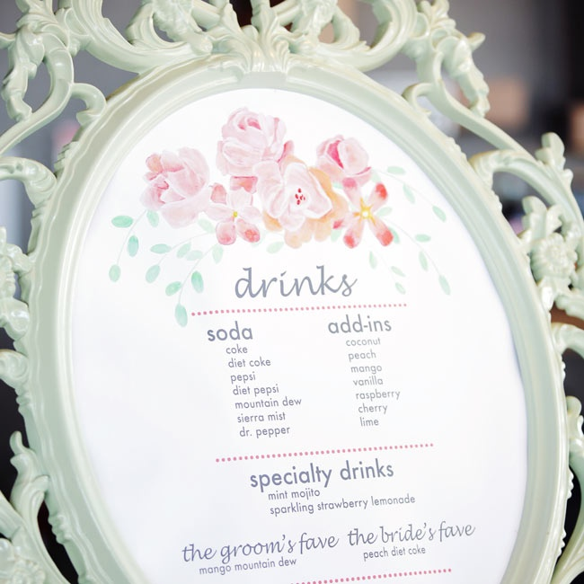 The drink menu, which consisted of sodas, fun flavor add-ins and specialty drinks, had a bright floral motif and was framed in a decorative frame in a pastel mint color.