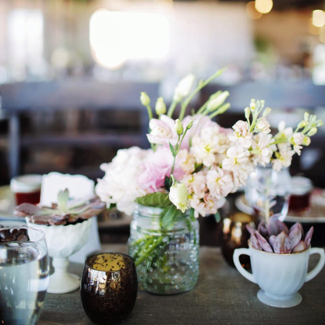 The couple struck the right balance between modern and rustic for their centerpieces with potted succulents and dotted mason jars filled with pastel stock flowers, roses and peonies.