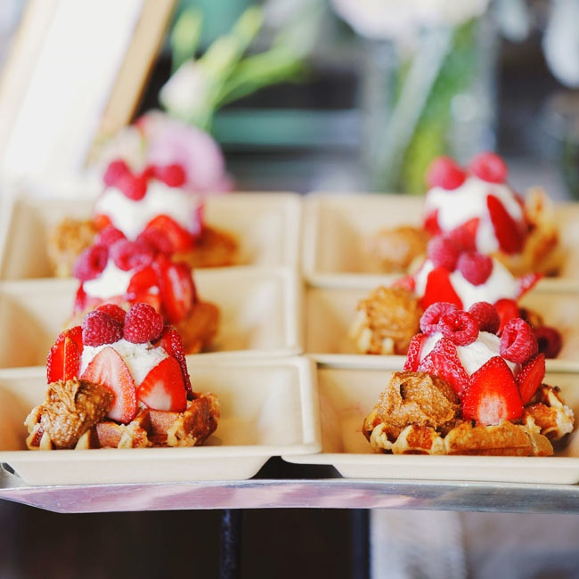 Jessica and Stephen both have a sweet tooth and would made numerous trips to waffle trucks while they were dating, so it was obvious that they had to serve the delicious treats at their wedding. The waffles were piled high with vanilla ice cream and fresh berries.