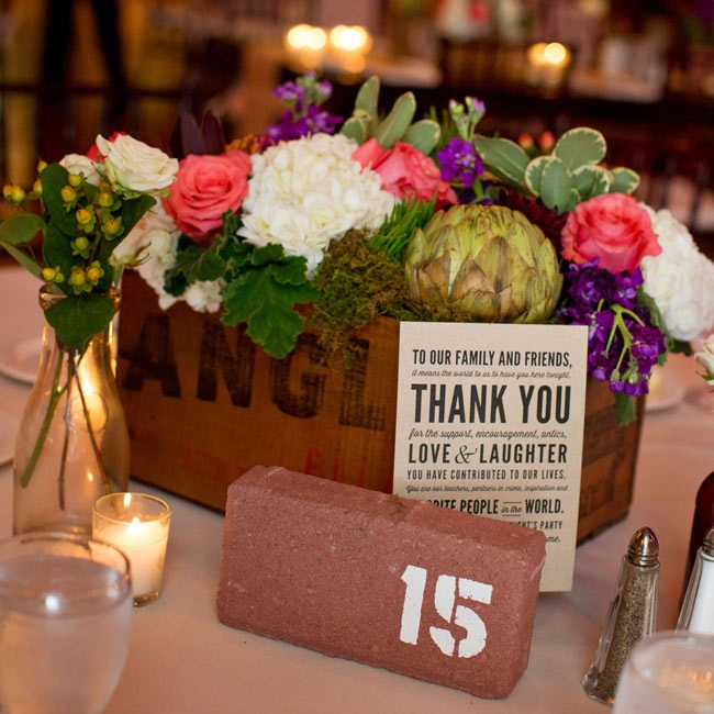 For an added industrial touch to the tablescapes, table numbers were printed on rustic bricks.