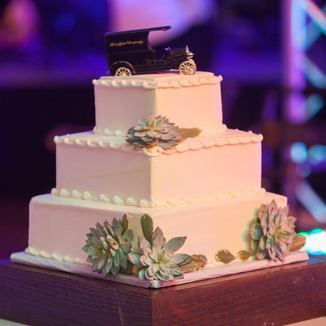 A few simple succulents adorned the square buttercream cake which was topped with a Henry Ford Model T vintage piggy bank given to the bride as a childhood gift from her grandfather.