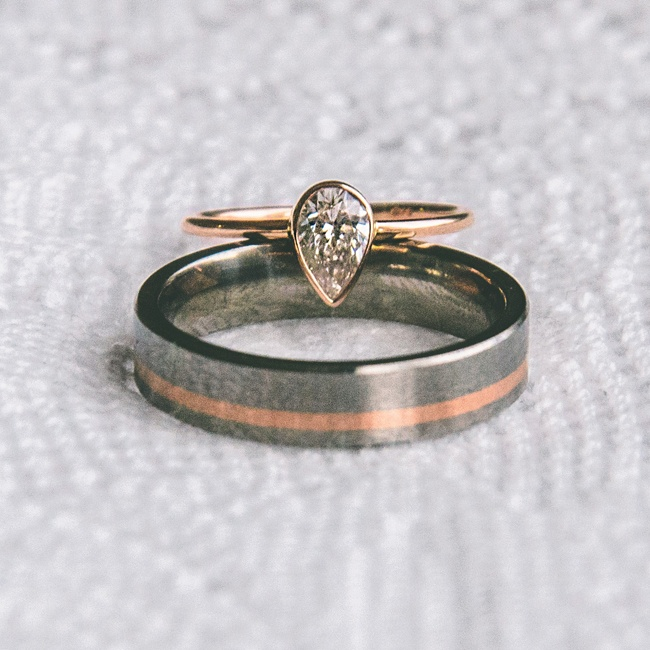 Mackenzie's elegant wedding ring was custom made and dainty with a small teardrop-shaped diamond on a gold band. Sheehan's wedding band was simple and silver, made by Titanium Knights.