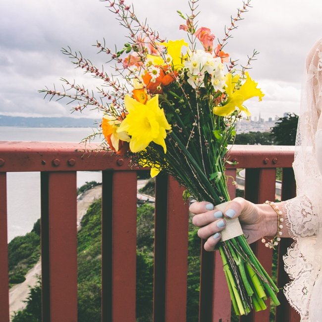 Mackenzie carried a beautiful bouquet of yellow daffodils with other brightly colored wildflowers. Her blue Essie nail polish had a fitting name for the occasion - Borrowed and Blue.