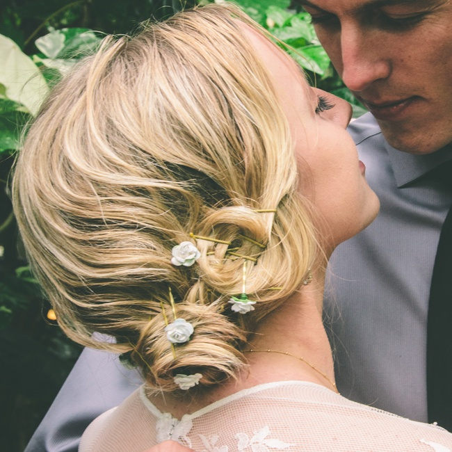 The bride had her hair done by photographer Arielle Vey. It was a loose updo pinned together by rose hair pins.