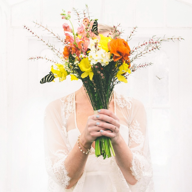 Following the ceremony, the bride and groom went to the Conservatory of Flowers nearby, which housed a butterfly enclosure. The butterflies landed on Mackenzie's bright bouquet during the photo shoot.