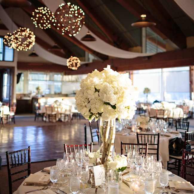 The reception was held at the Aspen Sundeck. The room had a warm, rustic feel with exposed wooden beams, cathedral ceiling and lots of natural light. The room gave guests great views of the Rocky Mountains.