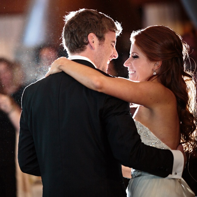 The couple had their first dance as family and friends looked on.