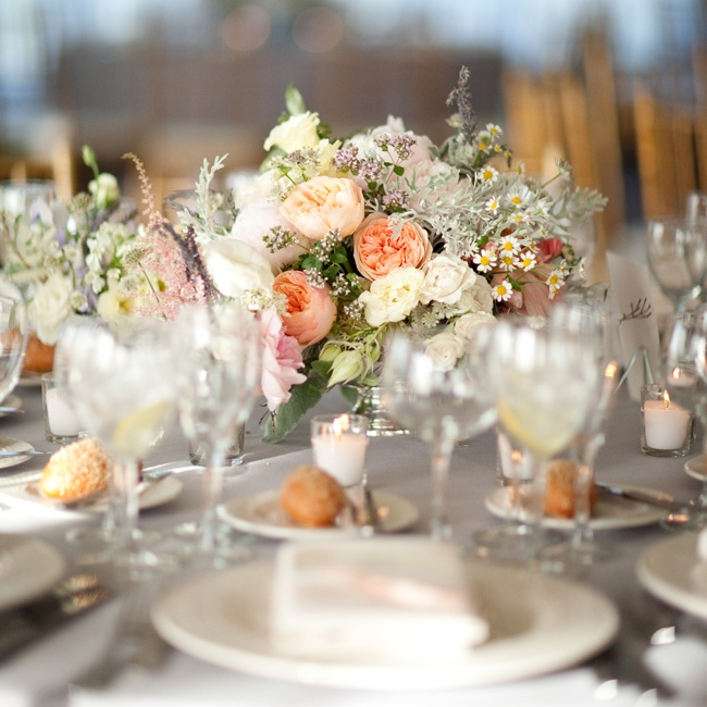 The centerpieces had a romantic, English garden look with dainty wildflowers, peonies and roses in soft pastel colors.