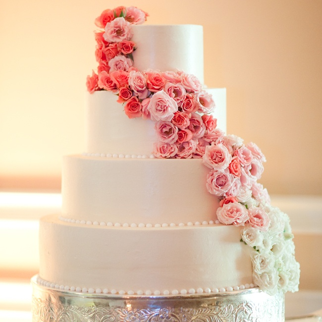 The couple gave their classic white cake a modern touch with a cascade of ombre roses.
