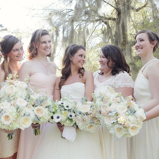 The bridesmaids wore their own dresses in shades of ivory and blush.