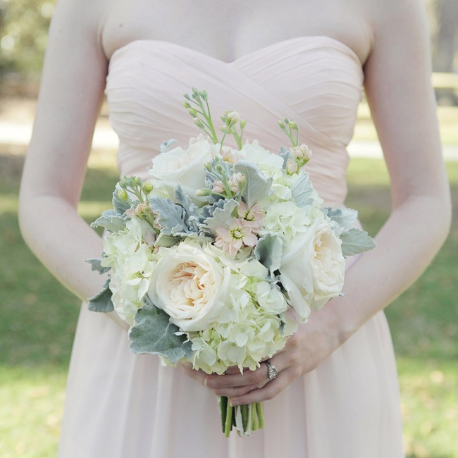 The bridesmaids' bouquets had a soft, romantic look with pale pink stock, blush roses, lamb's ear and ivory hydrangeas.