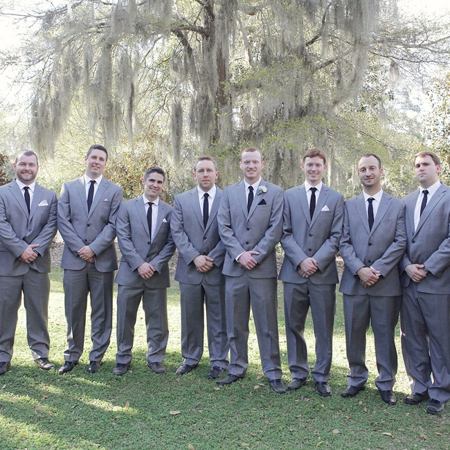 Curtis and his groomsmen wore classic gray, double breasted suits with skinny black ties.