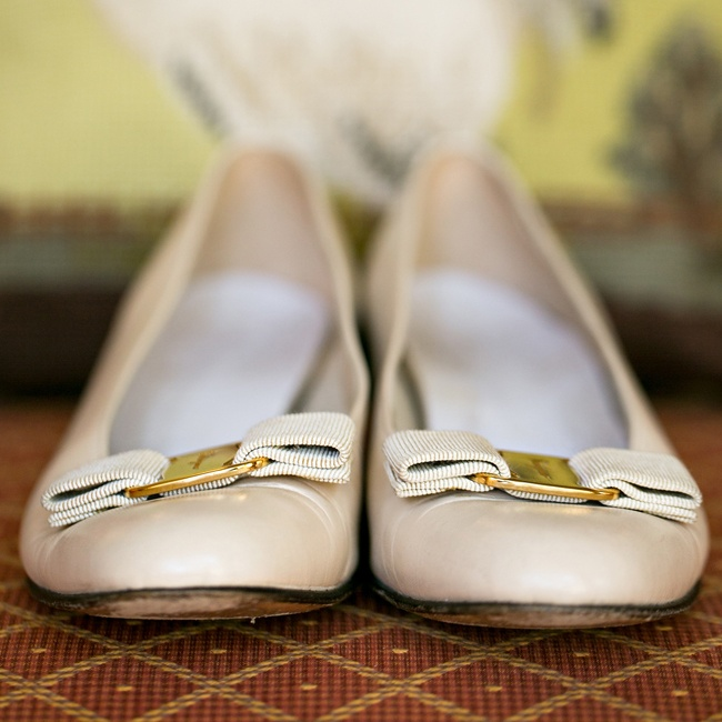 Kristin donned these golden flats with bow detailing and a metallic buckle for her trip down the aisle.