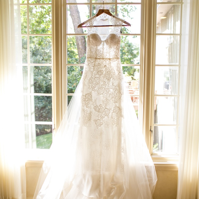 The bride wore this floral lace Monique Lhuillier gown with an illusion neckline and a sweetheart cut.