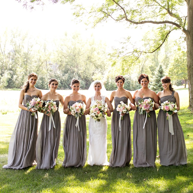 Kristin's bridesmaids wore floor-length gray, strapless gowns down the aisle.