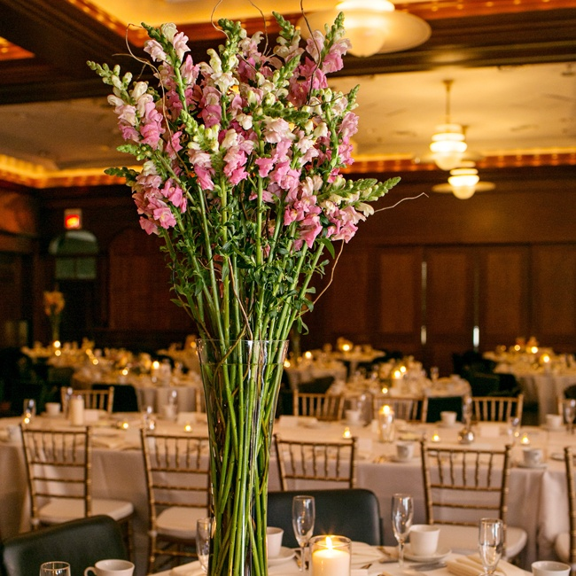 Tall, pink arrangements of stock flowers graced some of the reception tables to add height to the space.