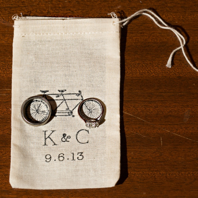Kristin and Casey's guests received their favors in these muslin bags with a tandem bike motif and personalized date and initials.
