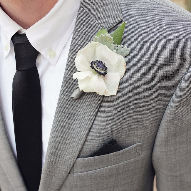 Ivory anemone boutonnieres added a playful touch to the groomsmen's lapels.