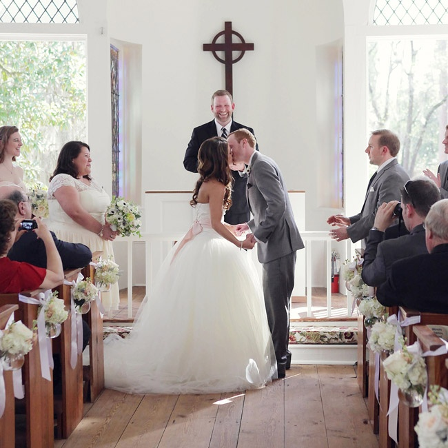 The couple exchanged vows in a traditional religious ceremony at the Mt. Lebanon Chapel over looking the Airlie Gardens.
