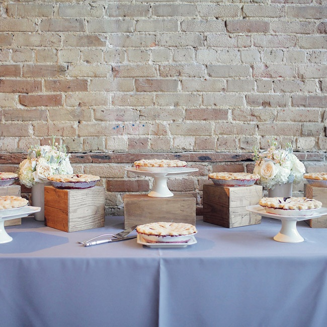 The desserts were displayed on simple ivory cake stands and vintage wooden boxes of a rustic look.