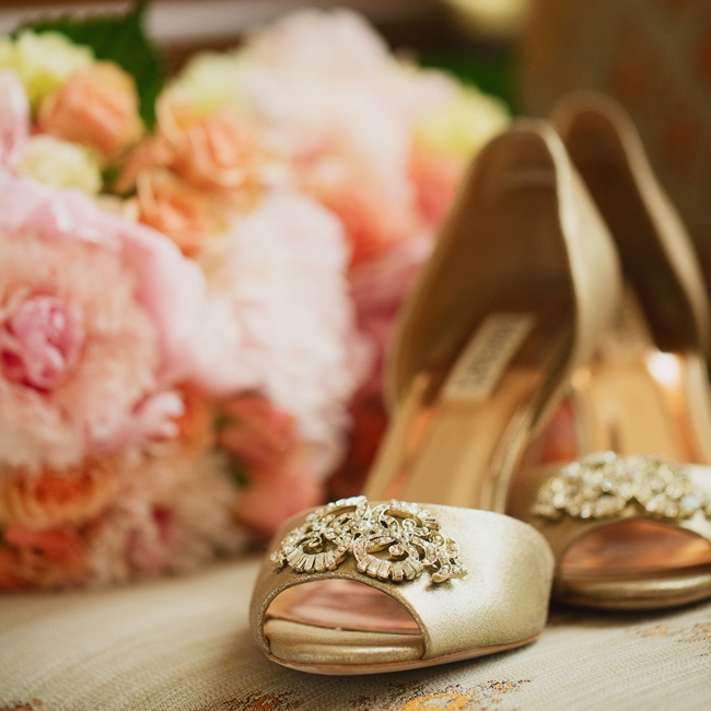 Kate walked down the aisle in these champagne colored peep-toe heels with beaded embellishments.