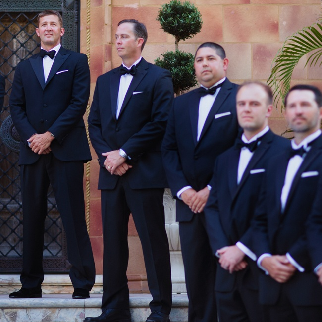 Groomsmen donned traditional dark suits and matching bowties for the ceremony.