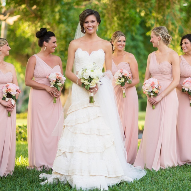 Kate's bridesmaids wore floor-length, one-shoulder blush gowns with matching bouquets.