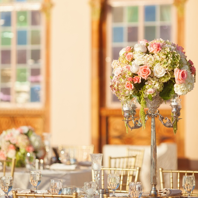 Tall candelabras were topped with large pink and white floral arrangements.