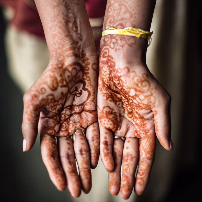 For her traditional Indian ceremony, Renuka was tattooed with henna designs.