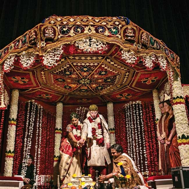 Renuka and John had two weddings. One was a traditional Indian Hindu wedding, and the other was a typical Christian ceremony and reception. Both events took place at the Peabody Opera House in St. Louis, Missouri.