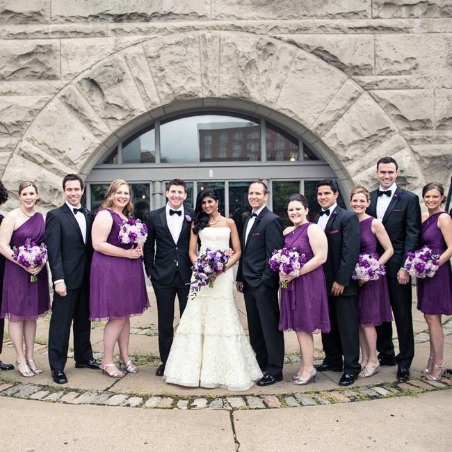 For their Christian ceremony, the bride wore a tiered lace bridal gown and her bridesmaids wore purple dresses. Groomsmen donned matching tuxedos with bowties.