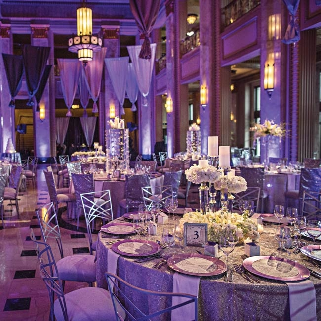 Inside the opera house, the couple used lighting and metallics to create the lush, elegant purple atmosphere.