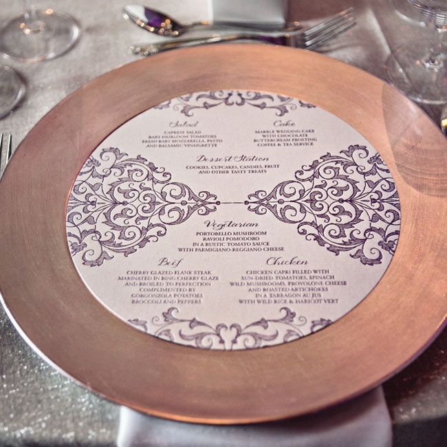 Circular menu cards outlined the guests dinner choices and were presented on top of the metallic chargers at eat place setting.