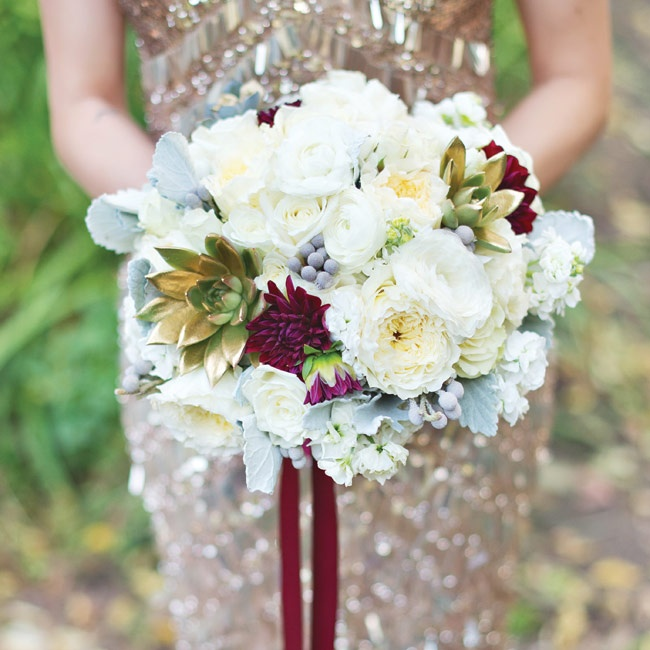 Elise wanted to incorporate her favorite flowers - ranunculuses and peonies - into a bouquet with lots of texture and diversity. She paired the soft ivory flowers with gold-tipped succulents, deep burgundy dahlias, gray berzelia and lamb's ear for a unique bouquet with lots of depth.