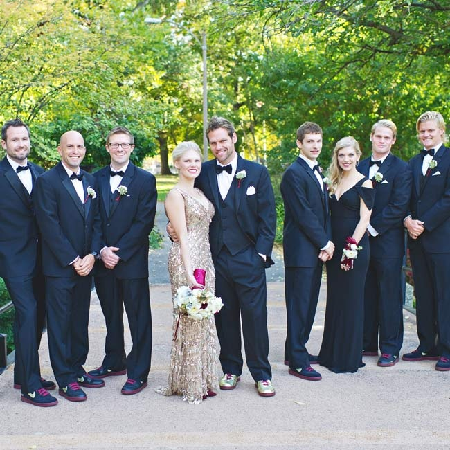 For a timeless, classic look, the groomsmen wore Calvin Klein three-piece black tuxedos with black bow ties and white pocket squares. Phil wore a similar style by Vera Wang.