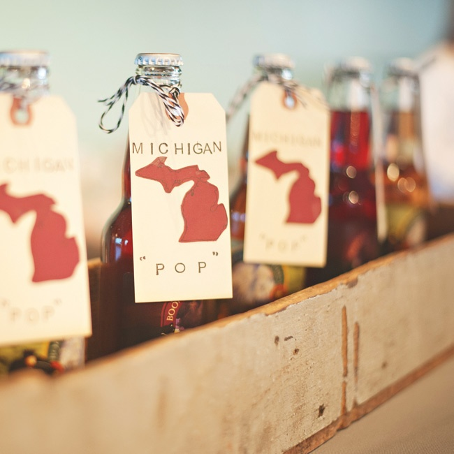 As a nod to Phil's childhood summers in Michigan, the couple displayed old-fashioned bottles of soda from a shop called Cherry Republic in Glen Arbor, MI in a vintage milk carrying crate on the bar. A handmade tag was tied around each bottle.